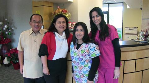 Dr. Oriel, second from left, with her staff.